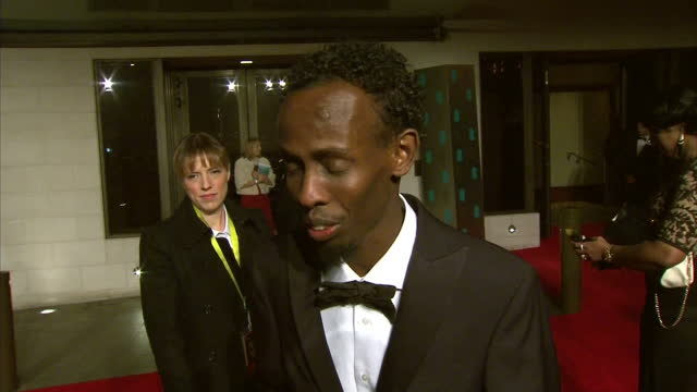exterior interview with actor barkhad abdi speaking about winning a bafta for best supporting actor in his first ever movie role in 'captain... - best supporting actor stock videos & royalty-free footage
