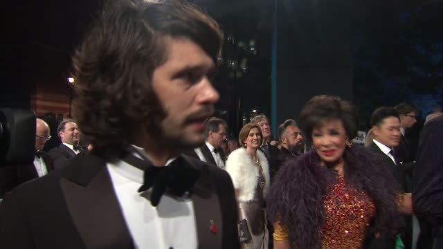 exterior interview with ben whishaw on the red carpet at the royal world premiere of 'spectre' at royal albert hall on october 27, 2015 in london,... - james bond fictional character stock-videos und b-roll-filmmaterial