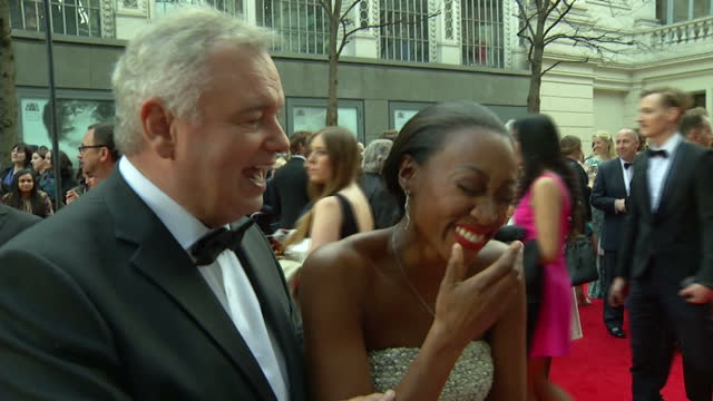 exterior interview with beverley knight at the olivier awards 2015 who is interupted by eamonn holmes. on april 12, 2015 in london, england. - エイモン ホームズ点の映像素材/bロール