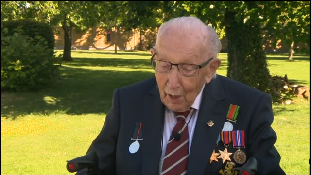 exterior interview with captain tom moore about being knighted after the war veteran raised more than £32m for nhs charities by completing 100 laps... - captain tom moore stock videos & royalty-free footage