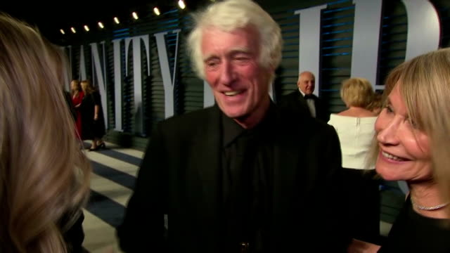exterior interview with cinematographer roger deakins, accompanied by screenwriter isabella james purefoy ellis, speaking about his reaction to... - scriptwriter stock videos & royalty-free footage