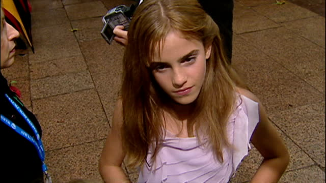 exterior interview with emma watson at the premiere of harry potter and the chamber of secrets. on november 3, 2002 in london, england. - film premiere stock videos & royalty-free footage