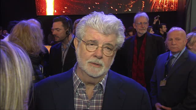 Exterior interview with George Lucas at the premiere of Star Wars The Force Awakens what he thinks of the new film and his feelings about handing it...