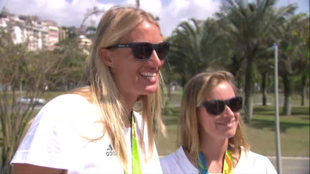 exterior interview with hannah mills and saskia clark team gb sailors and rio 2016 gold medallist talk about winning olympic gold medal preparations... - olympic medal stock videos & royalty-free footage