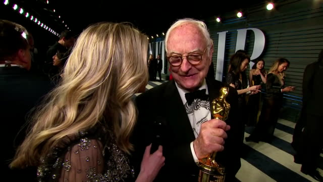 exterior interview with james ivory showing off his oscar and speaking about his reaction to winning the academy award for best adapted screenplay... - call me by your name stock videos & royalty-free footage