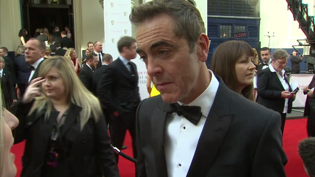 exterior interview with james nesbitt, actor at tv baftas on 'the missing' at theatre royal on may 10, 2015 in london, england. - 英国アカデミー賞テレビ部門点の映像素材/bロール