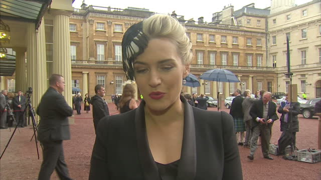 exterior interview with kate winslet about receiving her cbe for services to drama. kate winslet receives cbe for her services to drama at buckingham... - kate winslet stock videos & royalty-free footage
