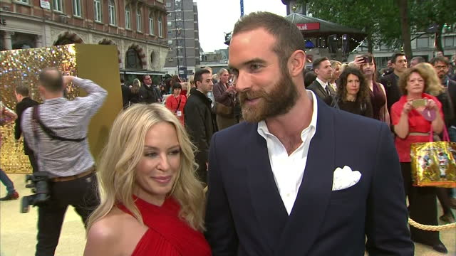 exterior interview with kylie minogue and joshua sasse at the premiere of absolutely fabulous the movie speaking about kylie having recorded the... - absolutely fabulous stock videos and b-roll footage