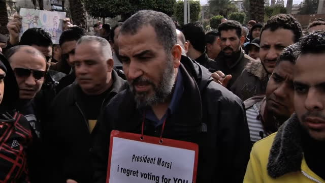 exterior interview with local protester & university professor on his regret for voting for president mohamed morsi. anniversary of football riots in... - port said stock videos & royalty-free footage
