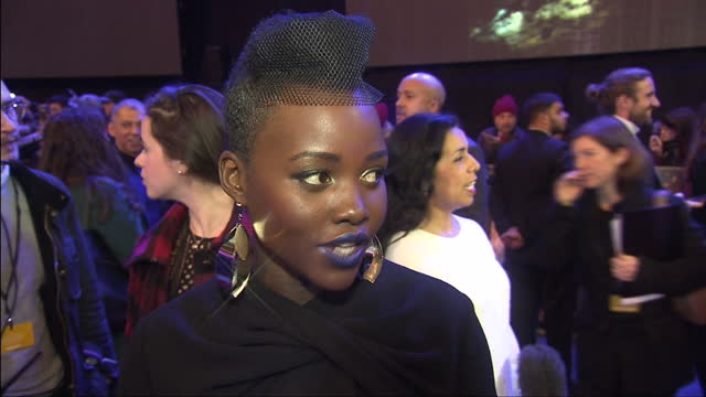 exterior interview with lupita nyong'o at the premiere of star wars the force awakens about her experience on star wars at leicester square on... - lupita nyong'o stock videos and b-roll footage