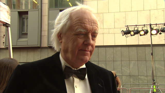 exterior interview with lyricist sir tim rice on the laurence olivier awards red carpet sir tim rice interview on the red carpet on april 12 2012 in... - tim rice stock videos and b-roll footage