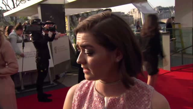 exterior interview with maisie williams on the bafta television awards red carpet.on may 08, 2016 in london, england. - 英国アカデミー賞テレビ部門点の映像素材/bロール