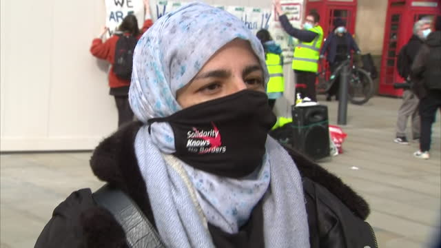 exterior interview with protester, nahella ashraf speaking in regards to the nhs pay protest, the protest being shut down by police for being... - paying stock videos & royalty-free footage