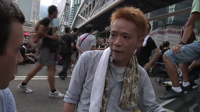 Exterior interview with Raymond Lam Hong Kong student protester talking about similarities between this protest and Tiananmen Square protest as well...