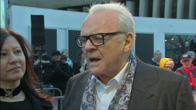 exterior interview with sir anthony hopkins on red carpet answering questions about hitchcock's relationship with his wife alma. hopkins wife stella... - an answer film title stock videos & royalty-free footage