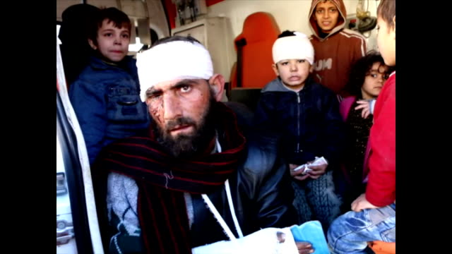 Exterior interview with Syrian man with injured head about having to leave Aleppo as there is no medicine food or drink for the kids there audio of...