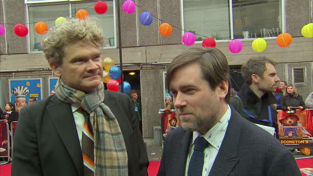 exterior interview with writer simon farnaby and director paul king on the red carpet at the premiere of paddington 2>> on november 05 2017 in london... - ディレクター点の映像素材/bロール