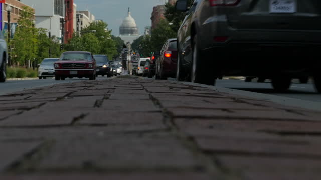 Exterior low angle arty shots of traffic passing in front of the Capitol Building on 6 July 2016 in Washington DC