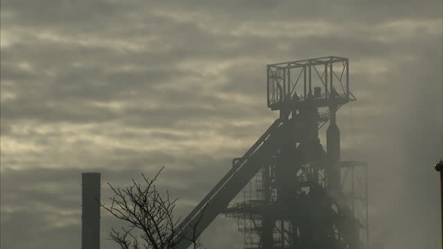 exterior mid shots tata steel works building with smoke coming from site on a cloudy misty day, dramatic arty moody picture on february 15th 2017 in... - mid wales stock videos & royalty-free footage