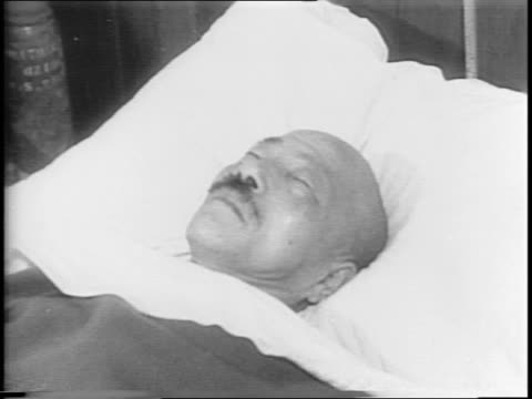 Exterior montage of evacuation hospital Japanese Prime Minister Hideki Tojo lays in hospital bed / Shot of Tojo's knife and a gun he used in suicide...