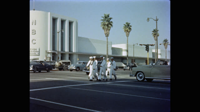 exterior nbc building, group of sailors crossing the street, los angeles, california, usa - nbc stock videos & royalty-free footage