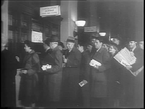 exterior new york general post office / people standing in line at the post office / medium shots of a sheet of stamps being passed through a window... - postal stamp stock videos and b-roll footage