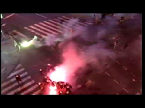 exterior night high shots clashes, street battles between radovan karadzic supporters & riot police. - radovan karadzic stock videos & royalty-free footage
