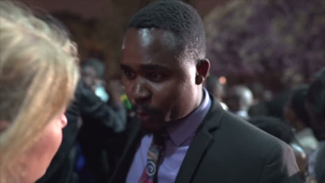 exterior night interview with protesting lawyer at a rally against the imprisonment of pastor evan mawarire on july 13 2016 in harare zimbabwe a... - pastor stock videos & royalty-free footage
