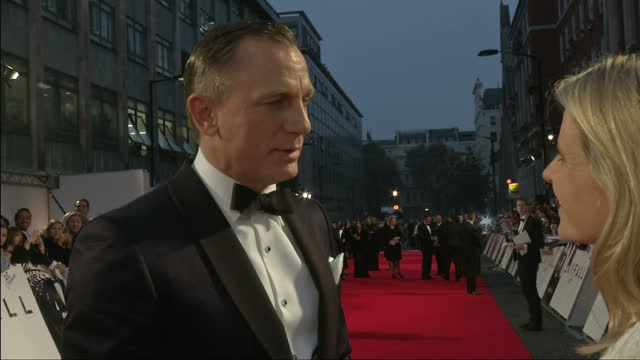 exterior night shot daniel craig speaks on his role in skyfall daniel craig grab on the red carpet on october 23 2012 in london england - skyfall 2012 film stock videos and b-roll footage