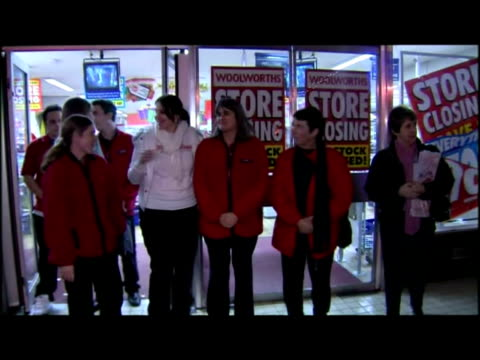 vídeos de stock, filmes e b-roll de exterior night shot old man walk out of woolworths store past store closing signs interior shots nearly empty store exterior nights shots woolworths... - woolworths
