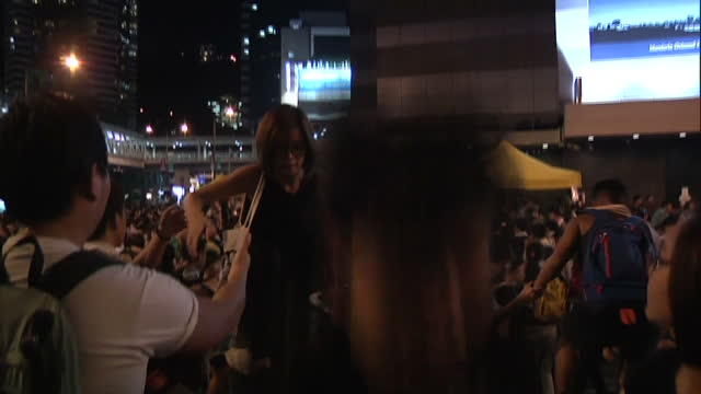 exterior night shot showing protesters climb over barricade during large protest on september 30 2014 in hong kong hong kong - barricade stock videos & royalty-free footage