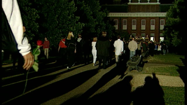 exterior night shots crowds of people outside kensington palace on in london england - kensington palace video stock e b–roll