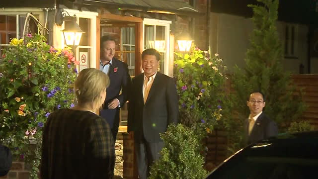Exterior night shots David Cameron British Prime Minister and Xi Jinping Chinese President arrive at The Plough pub and pose outside for photographs...