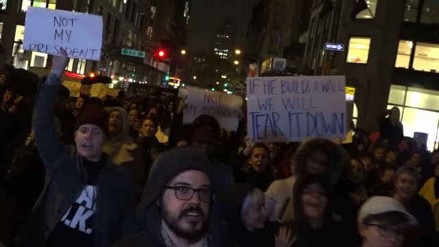 Exterior night shots Democrats and antiDonald Trump supporters marching through streets of New York in protest at Donald Trump being elected as the...