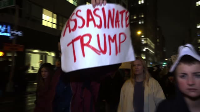 exterior night shots democrats and anti-donald trump supporters marching through streets of new york in protest at donald trump being elected as the... - president stock videos & royalty-free footage