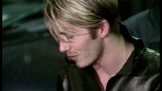 stockvideo's en b-roll-footage met exterior night shots footballer david beckham speaking to press outside the portland hospital regarding birth of his first son brooklyn joseph... - 1999