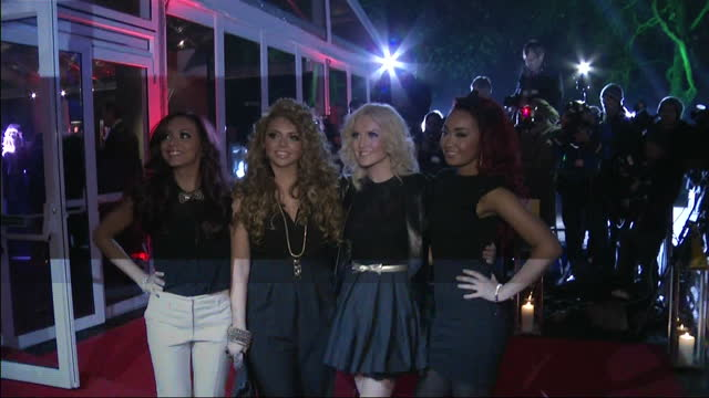 stockvideo's en b-roll-footage met exterior night shots girl band xfactor winners little mix pose on the red carpet outside the imperial war museum entrance little mix pose on the red... - imperial war museum museum