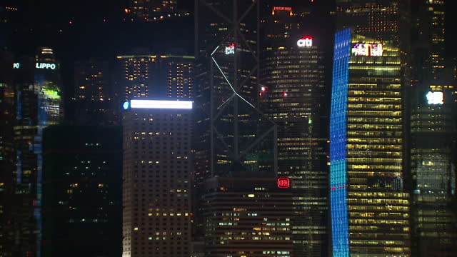 exterior night shots hong kong harbour buildings lit up including lights shining from hsbc building and bank of china tower lit up hong kong... - bank of china tower hong kong stock videos & royalty-free footage