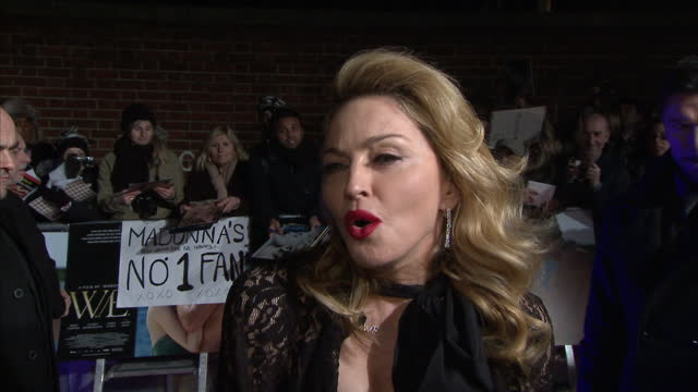 exterior night shots interview with madonna on her new film w.e at the london premiere madonna interview at the w.e premiere on january 11, 2012 in... - マドンナ点の映像素材/bロール