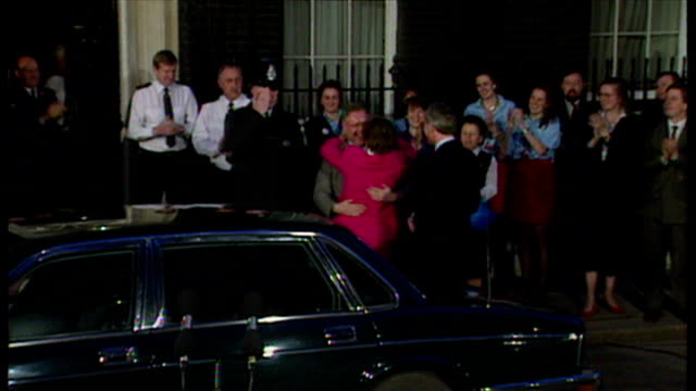 exterior night shots john major prime minister arriving at downing street after winning the 1992 general election he gets out of the car with wife... - john major stock-videos und b-roll-filmmaterial