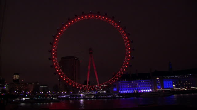 exterior night shots london eye lights go off for earth hour on march 19 2016 in london england - earth hour stock videos & royalty-free footage