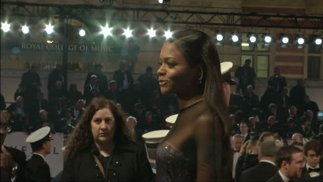 exterior night shots naomie harris poses on the red carpet at the world premiere of skyfall naomie harris poses on the red carpet on october 23 2012... - skyfall 2012 film stock videos and b-roll footage