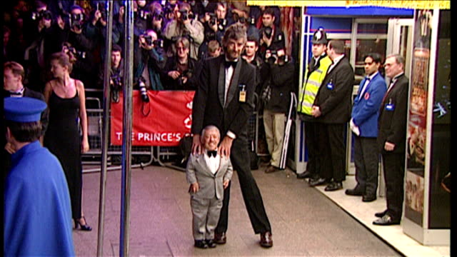 exterior night shots of actors peter mayhew kenny baker arriving for star wars special edition premiere on march 20 1997 in london england - star wars stock videos & royalty-free footage