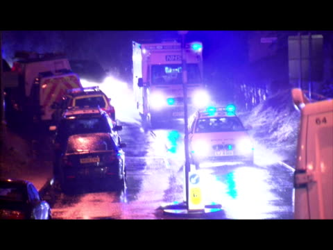 vidéos et rushes de exterior night shots of ambulance with blue flashing lights carrying raoul moat after he shot himself following a stand off with police ambulance... - nord est de l'angleterre