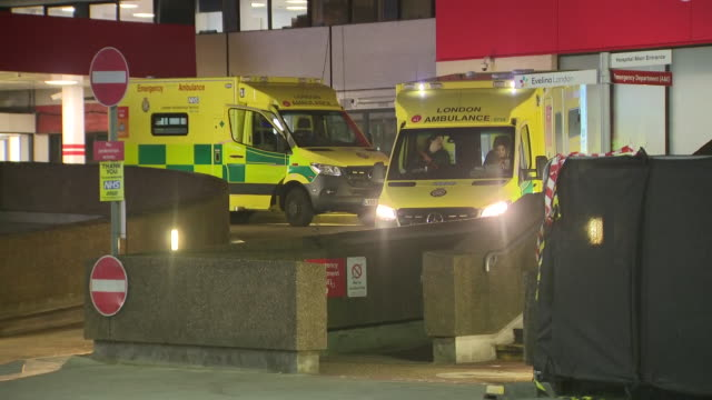 exterior night shots of ambulances in front of hospital on 18th april 2020 in london, england. - night stock videos & royalty-free footage