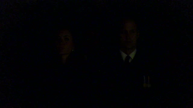 exterior night shots of australian soldiers at anzac day dawn service with soldier playing last stand on trumpet, william and catherine duchess of... - anzac day stock videos & royalty-free footage