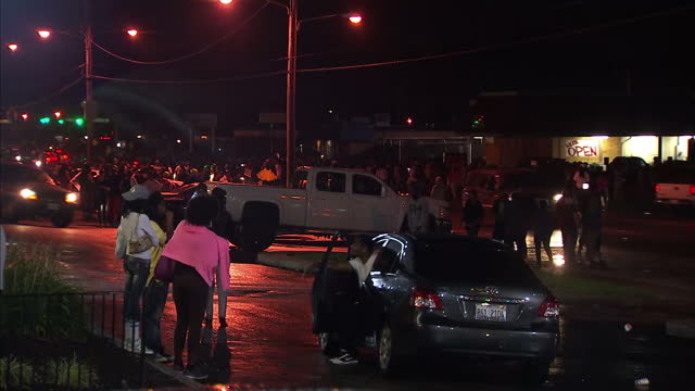 exterior night shots of crowds of protesters marching along the main road through ferguson demonstrating against the shooting of michael brown by a... - missouri stock videos & royalty-free footage