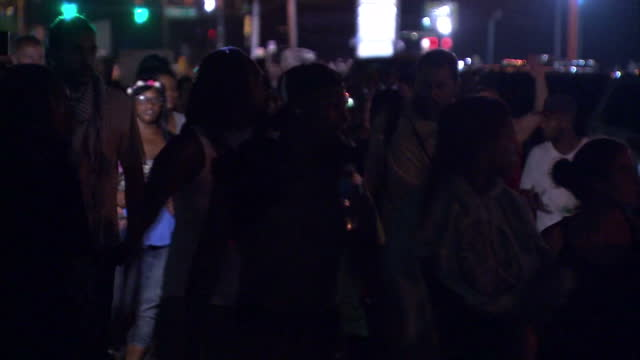 exterior night shots of crowds of protesters marching through ferguson>> on august 20 2014 in ferguson missouri - missouri stock videos & royalty-free footage