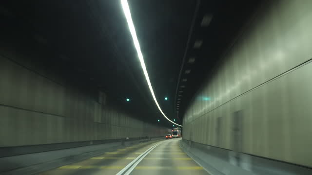 exterior night shots of driving through car tunnel on 30 august 2019 in hong kong, china. - tunnel stock videos & royalty-free footage