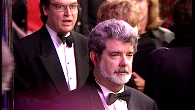 exterior night shots of george lucas arriving at the star wars special edition premiere shots of fans wiping tears from eyes on march 20 1997 in... - star wars stock videos & royalty-free footage